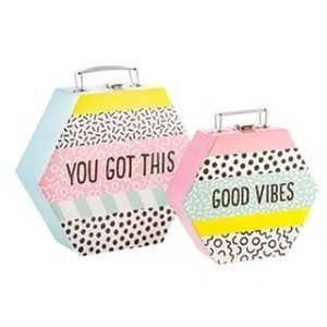 Storage boxes reading Good Vibes and You got this