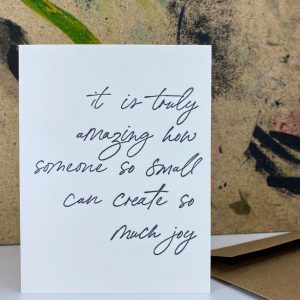 A new baby greeting card thats reads it is truly amazing how something so small can create so much joy